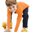 Stock Photo: The little girl on roller skates