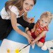 Cute little girl and mother drawing — Stock Photo #5253391