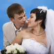 Loving groom and beautiful bride are happy together. — Stock Photo