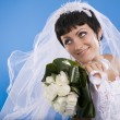 One happy and Beautiful  bride on blue background. — Stock Photo