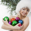 Girl plays with Christmas colorful ball — Stock Photo