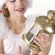 Little girl holds a Christmas lantern — Stock Photo