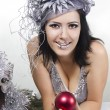 Cheerful girl bodyart with Christmas red ball — Stock Photo