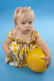 Little girl and yellow ball. — Stock Photo