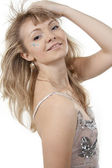 Beautiful coquettish girl the blonde on a white background — Stock Photo
