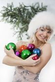 Girl plays with Christmas colorful ball — Stock Photo