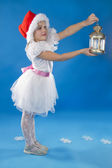 Cute little girl in claus hat — Stock Photo