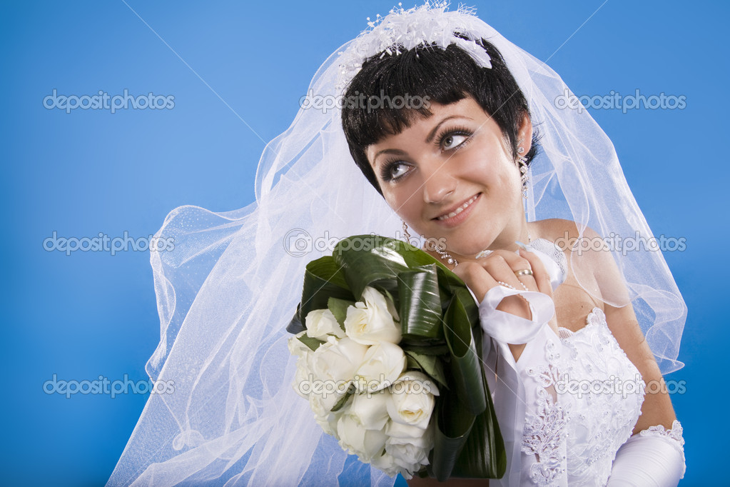 One happy and Beautiful  bride on blue background. — Stock Photo #5253877