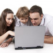 Family and computer — Stock Photo #5260130