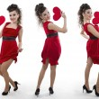 Women in a red dress shows the heart — Stok fotoğraf