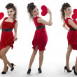 Women in a red dress shows the heart — Stock Photo
