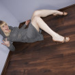 Lonely sexy women on a floor in an empty room — Stock Photo