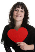 Big loving heart of the woman — Stock Photo