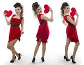 Women in a red dress shows the heart — Стоковое фото