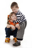 Happy both cheerful brother and the sister on roller skates — Stock Photo