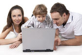 Family and computer — Stock Photo