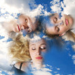 Three girls sleeping in clouds. - Stock Photo