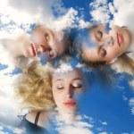 Three girls sleeping in clouds. — Stock Photo