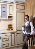 Young woman to kitchen in classical style — Stock Photo