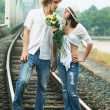 Couple on train tracks — ストック写真