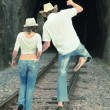 Couple on train tracks — Stock Photo #4137616