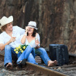 Couple on train tracks — Stockfoto
