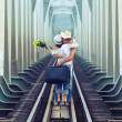Couple on train tracks - Stock Photo