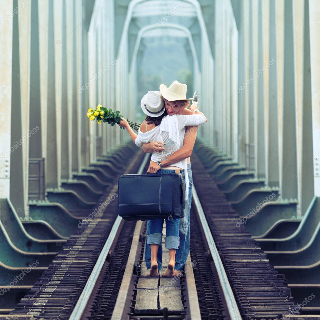 Young couple hugging on a train tracks — Stock Photo #4137673
