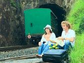 Couple on train tracks — Stock Photo