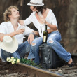 Couple on train tracks — Stock Photo