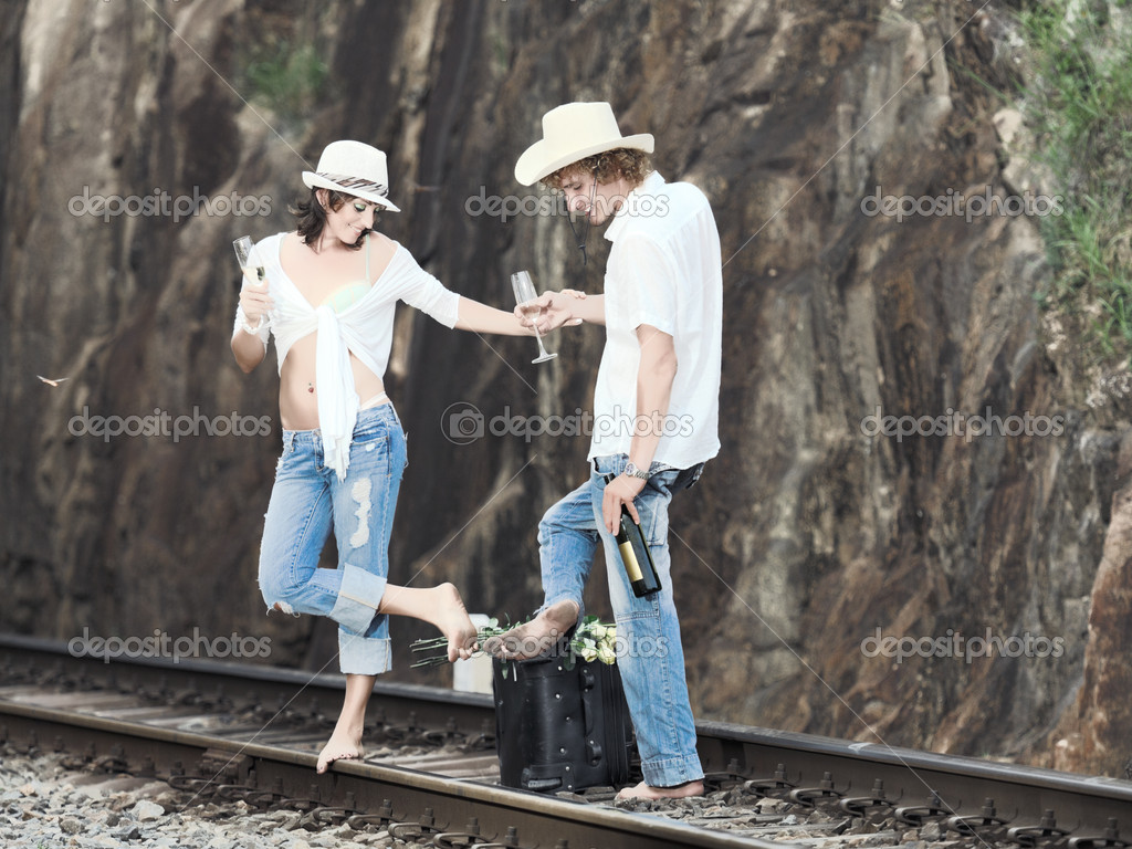 Young couple posing on a train tracks — Stock Photo #4286561