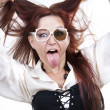 Red-haired woman sticking out her tongue — Stock Photo #4517454