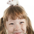 Stock Photo: Cheerful girl with rat on her head