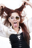 Red-haired woman sticking out her tongue — Stock Photo