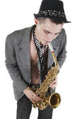 The young jazzman plays a saxophone — Stock Photo