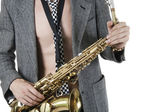 The young jazzman with a saxophone — Stock Photo