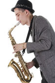 Young Jazz man playing on saxophone — Stock Photo
