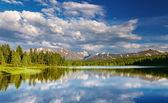 Mountain lake at sunset — Stock Photo