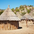 Traditional african huts, Namibia - Stock Photo