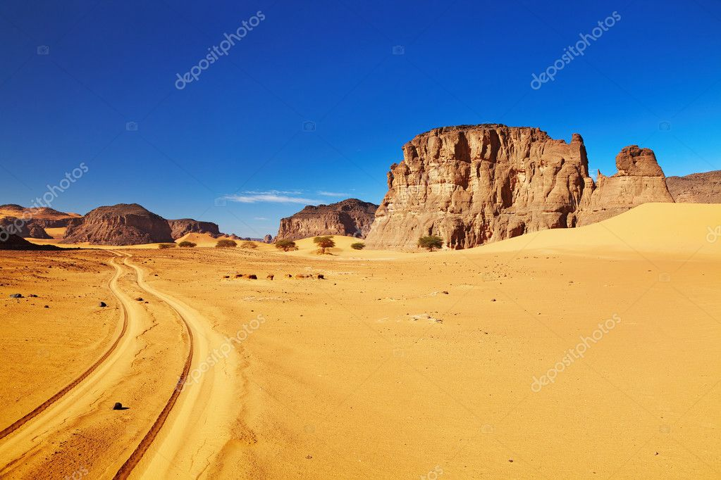Desert landscape with rocks and blue sky, Tadrart, Algeria  Stock Photo #4679666