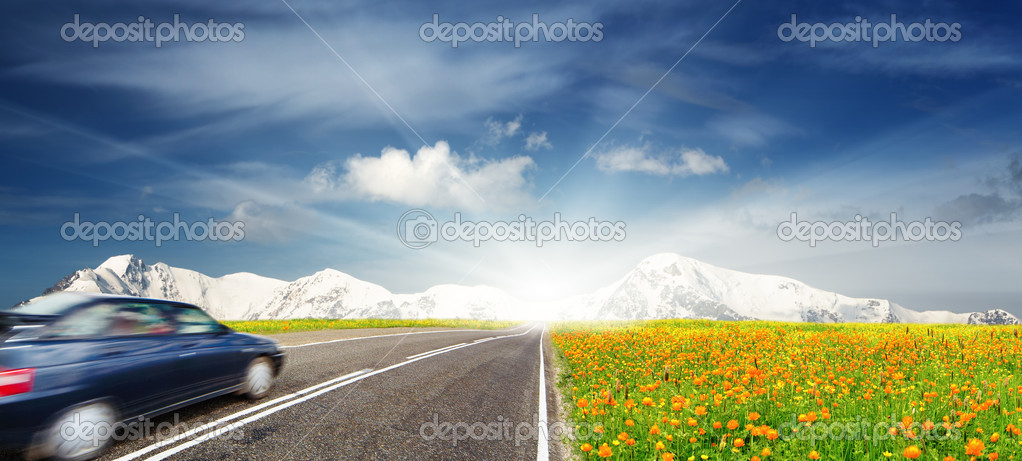 Mountain landscape with road and moving car  Stock Photo #4795380