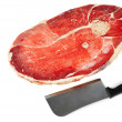 Piece of meat and knife - Stock Photo