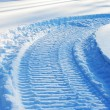 Stock Photo: Snowmobile track on snow