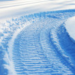 Snowmobile track on snow — Stock Photo #4177015
