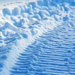 Snowmobile track on snow — Stock Photo