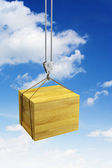 Hook holding wooden container — Stock Photo