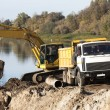 Foto Stock: Yellow excavator