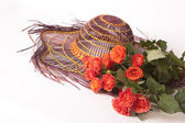Roses and hat orange — Stock Photo