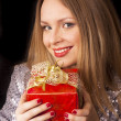 Happy girl with gift box — Stock Photo #5080346