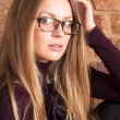 Girl with long hair in Glasses for the eyes — Stok fotoğraf
